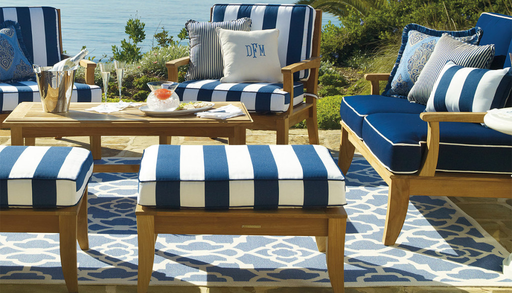 blue-outdoor-rugs-on-brown-floor-combined-with-stripped-puffs-chairs-table-and-sofa-1